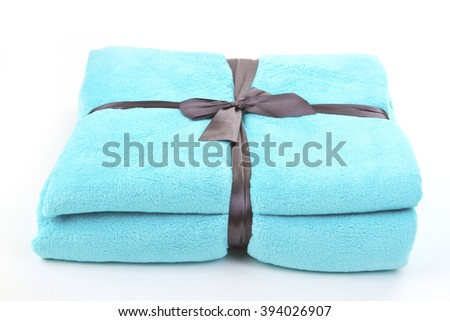 Blanket with ribbon isolated on white background - stock photo