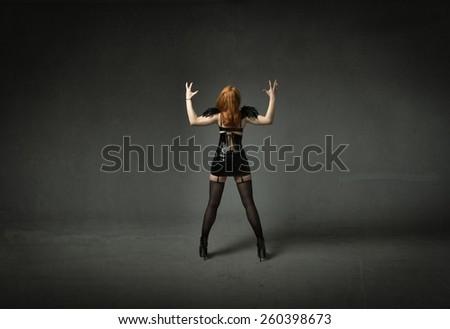 blaspheme anonymous girl - stock photo