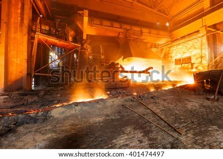 Blast furnace smelting liquid steel in steel mills - stock photo