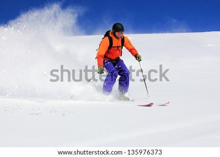 Blasting through fresh powder in the Utah mountains, USA. - stock photo