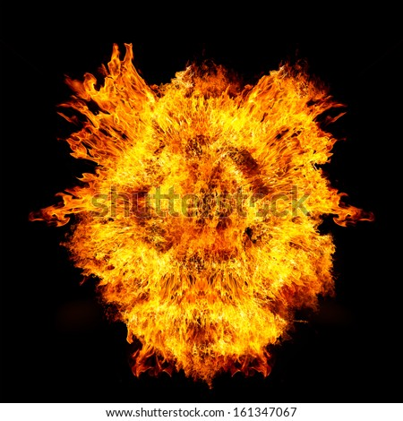 Blazing flames explosion over black background - stock photo