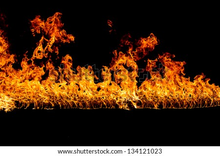 Blazing flames over black background - stock photo