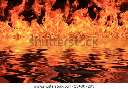 Blazing flames with water reflections over black background - stock photo