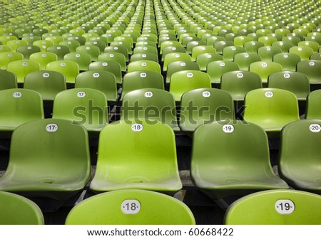 bleachers at stadium, endless rows of green plastic seats - stock photo