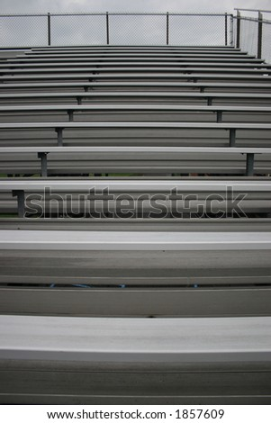 Bleachers in a stadium.  Great for a background or texture. - stock photo