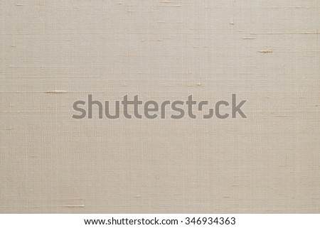 Blended cotton silk fabric wallpaper texture pattern background in light pale cream sepia beige color tone: Fine raw Thai silk detail textured organic fiber textile backdrop in tan toned colour - stock photo