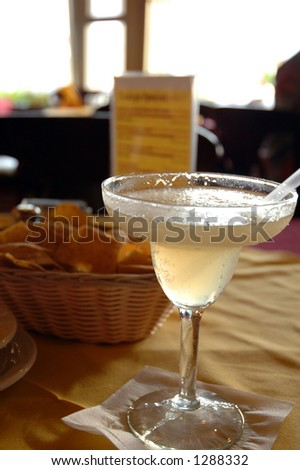 Blended margarita on a table in a restaurant - stock photo