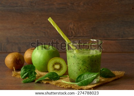 Blended smoothie with apple, kiwi and spinach - stock photo