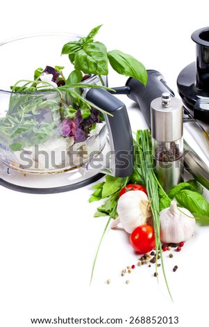 Blender with fresh vegetables and herbs - stock photo