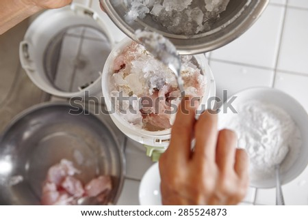 Blending the fish and ingredient using electric blender - stock photo