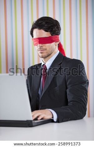 Blind businessman working at the office - stock photo