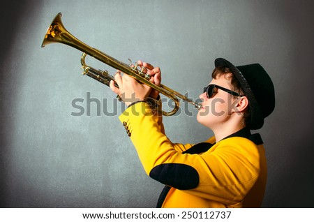Blind musician trumpet player playing trumpet at studio. Jazz-band - stock photo