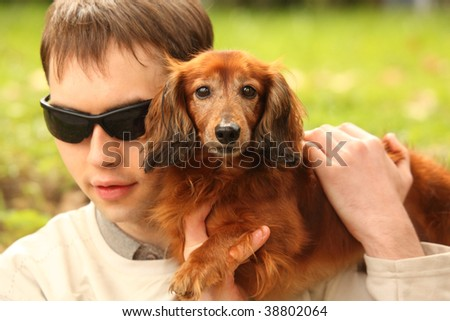 blind young man with dog-guide - stock photo