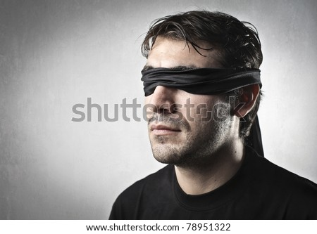 Blindfolded man - stock photo