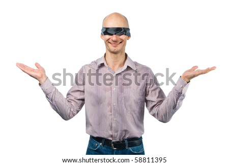 Blindfolded man throws up his hands - stock photo