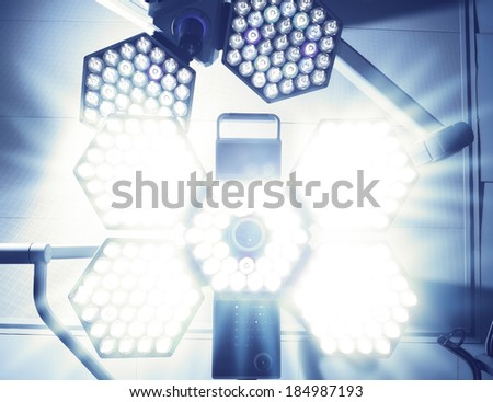 Blinding Light of surgical lamp. Fear of the patient before surgery - stock photo