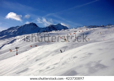 Blinding snow at a ski resort in the Alps mountains - stock photo