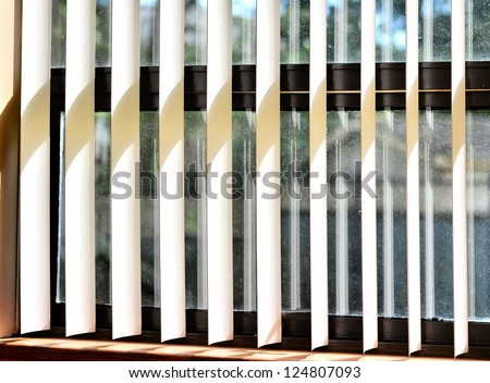 Blinds on the window - stock photo