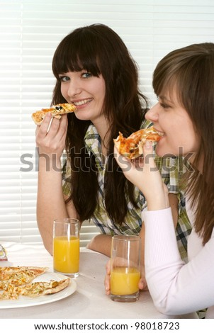Bliss Caucasian couple of people sitting eating pizza in a cafe - stock photo