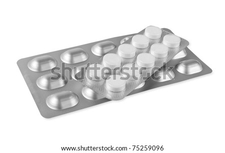 Blister with pills isolated on white - stock photo