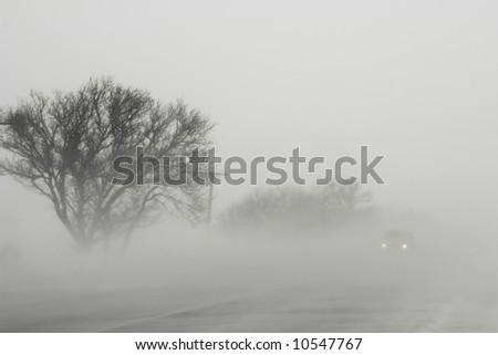 Blizzard on road among fields of Crimea - stock photo