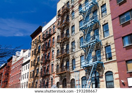 Block of colorful buildings in New York City - stock photo