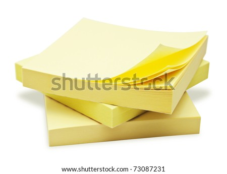Block of yellow Post it Notes isolated on white. - stock photo