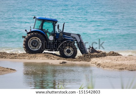 blocking the passage of the stream to the sea - stock photo