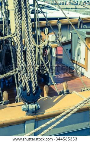 Blocks and tackles of a sailing vessel - stock photo