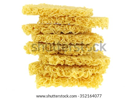 Blocks of raw and dried Instant yellow noodles, Asian ramen, isolated on a white background - stock photo