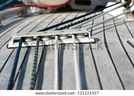 Blocks with rope on sailing boat in the sea - stock photo