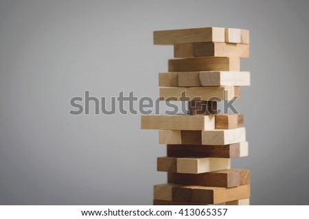 Blocks wood game (jenga) with copy space. - stock photo