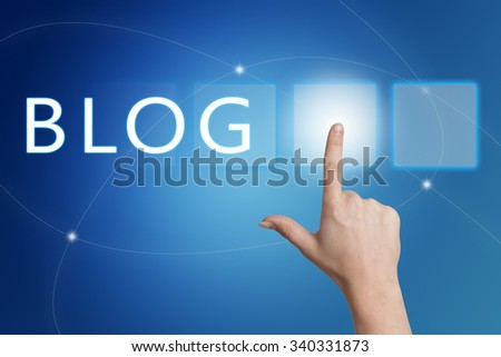 Blog - hand pressing button on interface with blue background. - stock photo