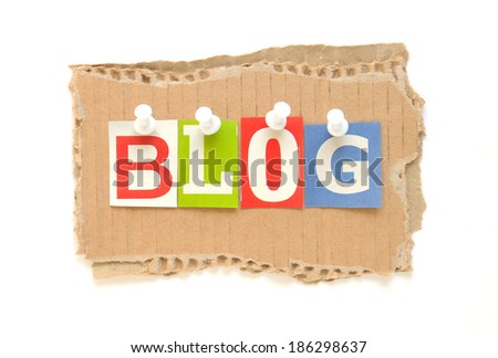 Blog with multicolored newspaper letters on a cardboard - stock photo