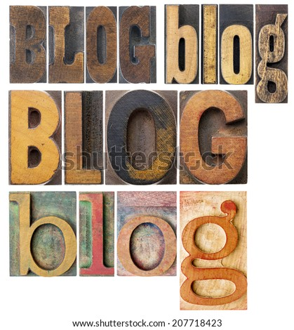 blog word in isolated antique wood letterpress printing blocks, stained by color inks, a collage of words in a variety of fonts - stock photo