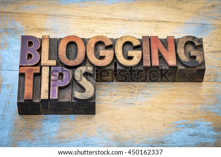 blogging tips - text in vintage letterpress wood type stained by color inks - stock photo