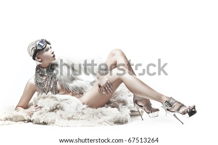 Blond beauty lying on the carpet - stock photo