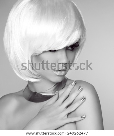 Blond bob hairstyle. Beauty portrait of fashionable girl model posing over studio gray background. - stock photo