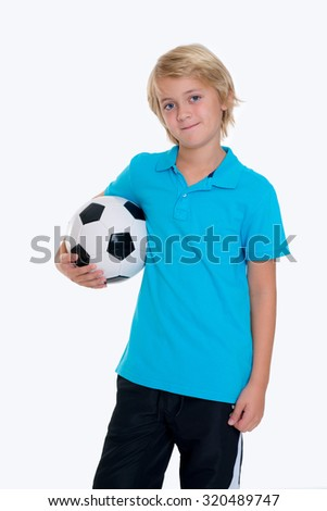 blond boy with soccer ball in front of white background - stock photo