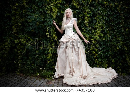 blond bride in white - stock photo