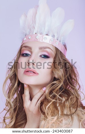 Blond bride with a creative headpiece - stock photo