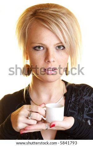 Blond business woman relaxing with coffee - stock photo