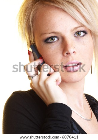 Blond business woman with mobile phone looking into the camera - stock photo