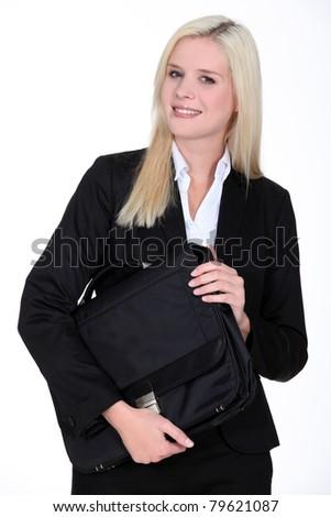 Blond businesswoman holding satchel - stock photo