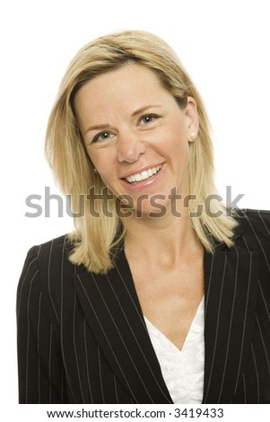 Blond businesswoman in a suit smiles against a white background - stock photo