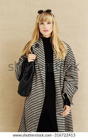 Blond businesswoman portrait in studio - stock photo
