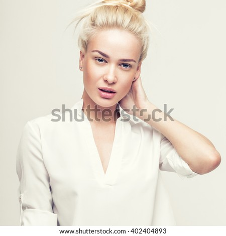 Blond cheerful young woman. Beauty portrait, perfect makeup. Model tests. Young girl in white. - stock photo