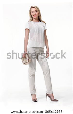 blond fashion model with long straight hair style girl in white trousers and short sleeve blouse heel shoes stand full body length portrait isolated on white - stock photo