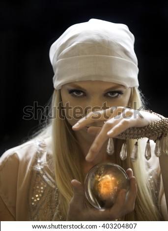 blond female fortune teller - stock photo