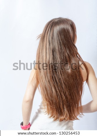 blond flying hair back view on gray background - stock photo